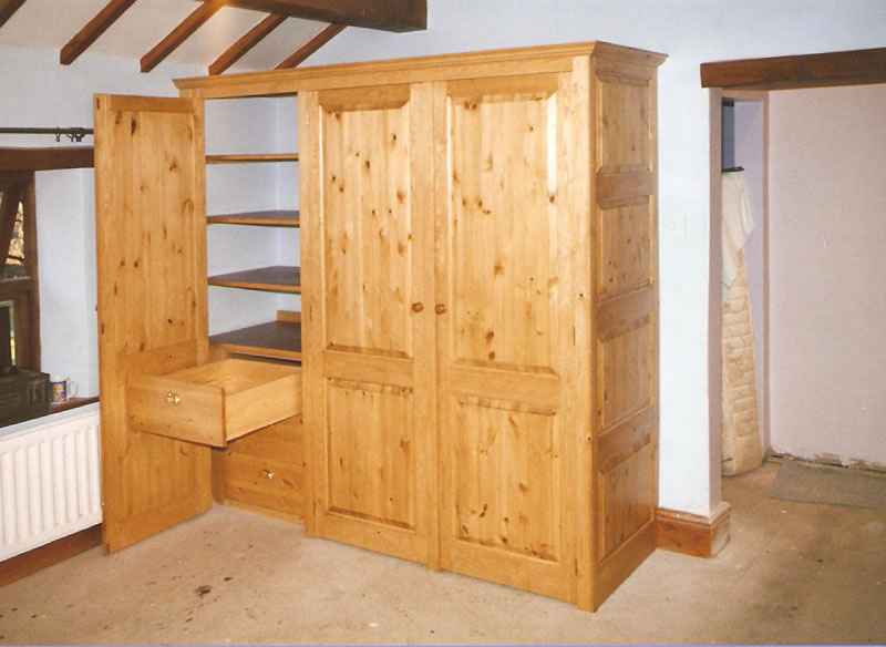 Pine wardrobe with raised and fielded panels