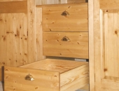 Pine wardrobe showing internal drawers