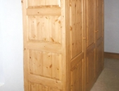 Pine wardrobe with raised and fielded panels side veiw showing scribed fit to the sloped ceiling