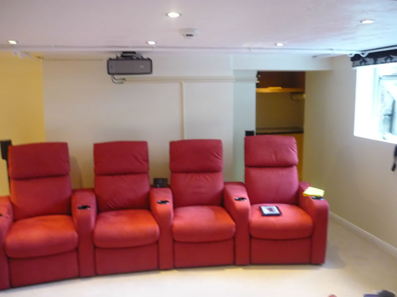 av-units-in-alcove-behind-seating