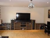av-unit-containing-suround-speakers-and-equipment-layout