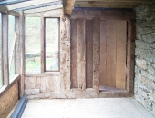 Plank and muntin style end wall with distressed ledge and braced door