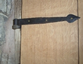 Traditional forged hinge in wrought iron with a knock in peg and pin