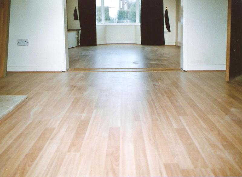 Laminate flooring laminate flooring through doorways for How to lay laminate flooring through a doorway