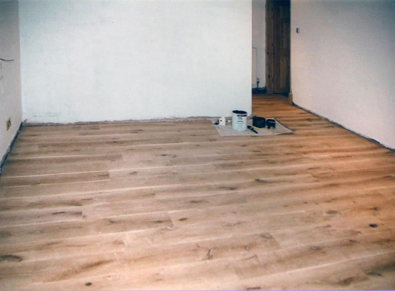 solid-oak-floor-with-brass-screwheads-sanded-flat-to-create-a-marine-appearance