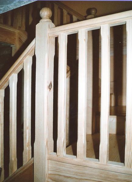 Completed landing section of yellow pine staircase