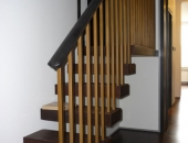Cantilever stairs in baked oak with oak handrail