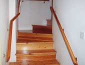 Modern style pine staircase with mopstick handrails