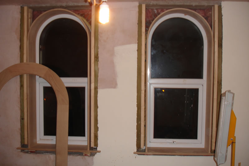 Arched windows with arched liners and architrave