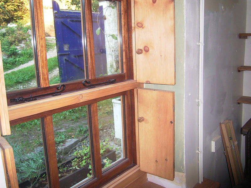 Storm proof windows with antique stlye shutters