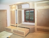 Tiered wardrobe with curved centre section showing full extension drawers and galley stle top storage
