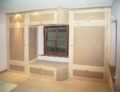Tiered wardrobe with curved centre section stepped design to fit around window positions