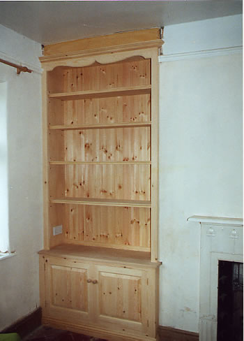 pine-alcove-dresser-style-units-with-a-gothic-shaped-top-rail-they-are-to-be-used-as-toy-storage