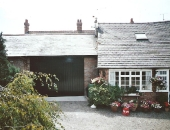 Classical style garage doors in keeping with the surroundings
