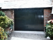 Classical style garage doors with adjacent pionting tidied up and concrete-ramp-renewed