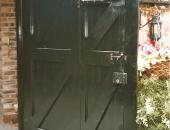 Garage doors with smaller access door