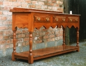 yew-dresser-base-with-shaped-bottom-rail-pot-boards-and-turned-legs