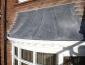 lead work repaced on an ornate bay window
