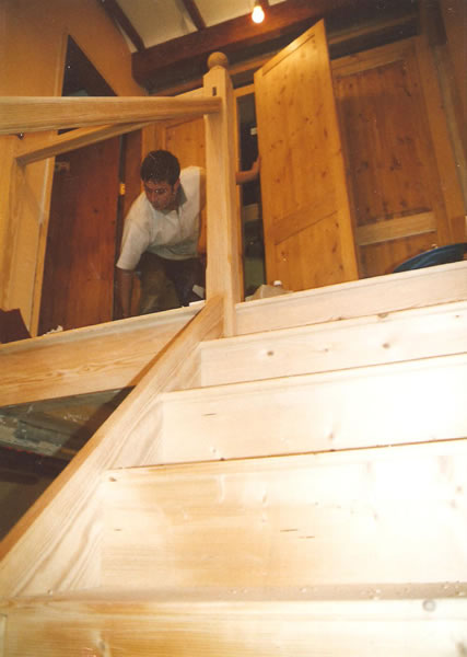 Landing cupboard doors being hung during stair case assembly
