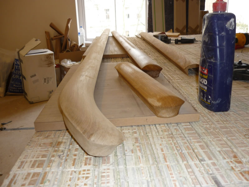 oak handrail prior to steam bending into position