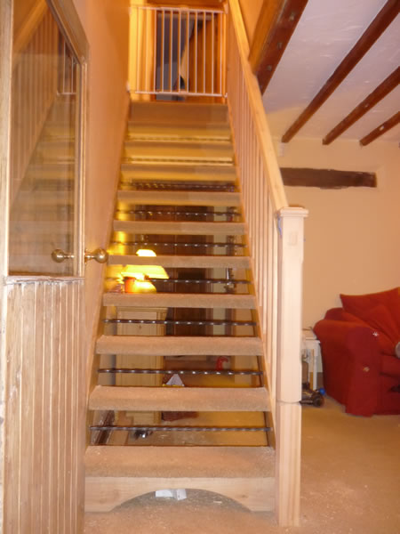 Pine stairs with twisted steel bars