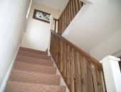 Replacement handrail and spindles on an original stair case