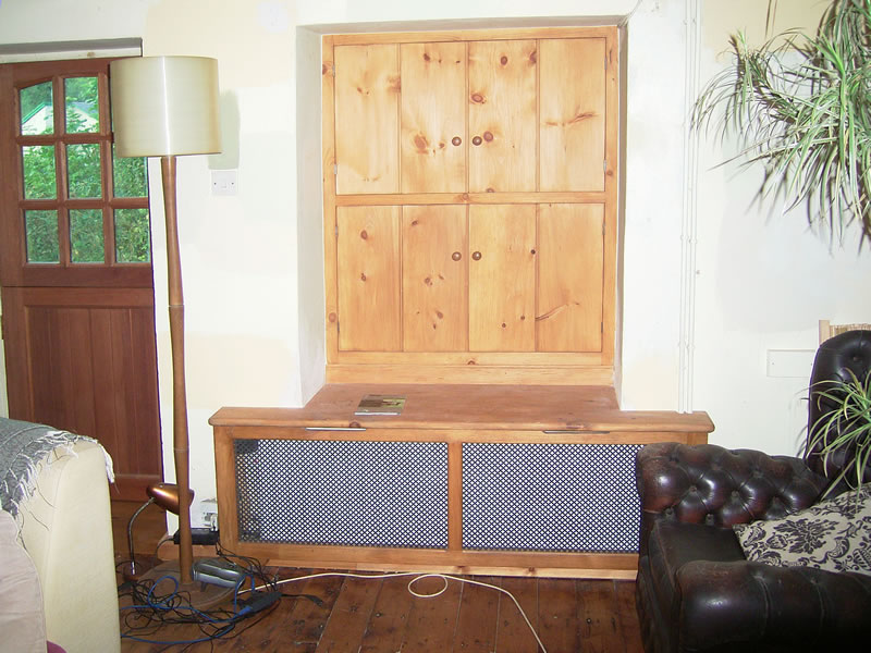 Antique style pine shutters and radiator cover with steel fretted panels