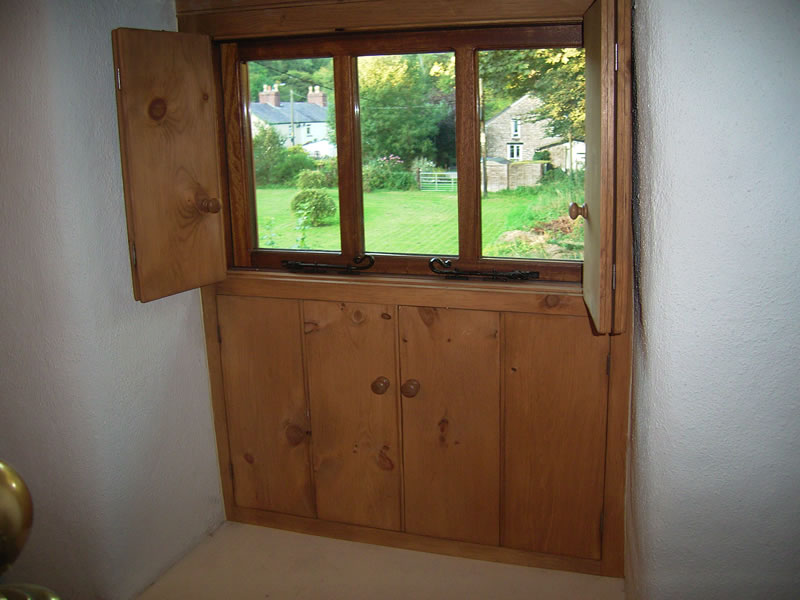 Part closed bedroom window shutters offering privacy whilst still letting in some light