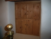 Closed bedrom window shutters giving a warm feel to the room